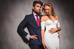 Embraced elegant fashion couple standing in studio Royalty Free Stock Photos
