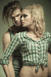 Embraced fashionable man and woman Stock Photography
