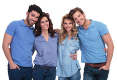 Embraced group of casual friends smiling Royalty Free Stock Photography