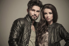 Embraced modern couple in leather jackets smiling Stock Photography