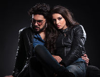 Embraced seated couple in leather jackets Royalty Free Stock Images