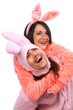 Embraces of  funny pink rabbits Stock Photos