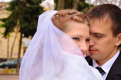 Embraces of a just married couple Royalty Free Stock Images