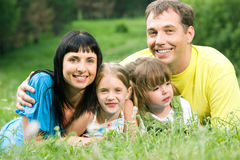 Embracing. Photo of father embracing his wife and two daughters stock photography