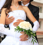 Embracing bride and groom Stock Image