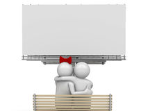 Embracing couple on a bench with copyspace Royalty Free Stock Photo