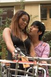 Embracing couple with bicycles stock images