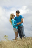 Embracing couple in countryside Royalty Free Stock Image