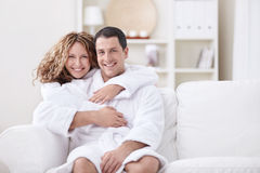 Embracing couple at home Royalty Free Stock Image