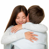 Embracing couple hugging happy stock photo