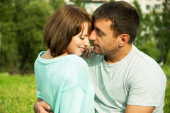 Embracing couple in love Stock Photos