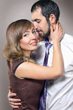 Embracing couple in love posing at studio Royalty Free Stock Photos
