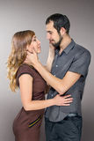 Embracing couple in love posing at studio Royalty Free Stock Image
