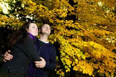 Embracing couple in park Stock Photo