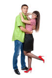 Embracing couple standing on white background Royalty Free Stock Photo
