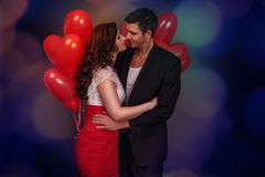 Embracing couple on valentine Stock Images