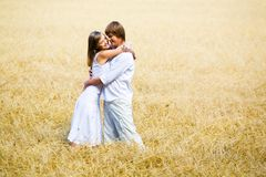 Embracing in field Stock Photography