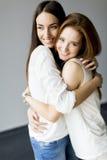 Embracing friends Stock Photos