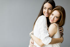 Embracing friends Royalty Free Stock Photo