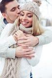 Embracing girlfriend Stock Image