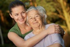Embracing grandmother. Young woman embracing her grandmother Stock Photography