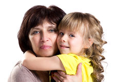Embracing grandmother and granddaughter Stock Photo