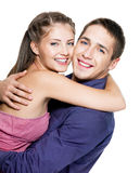 Embracing happy beautiful couple Stock Photos