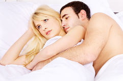 Embracing her in bed Royalty Free Stock Photo