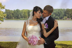 Embracing in love. Lovely newlyweds embracing. Photo taken in 2013 stock images