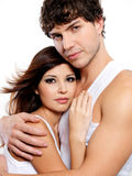 Embracing lovers. Two young beautiful embracing lovers - posing at studio Stock Image