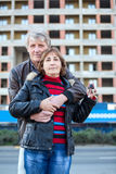Embracing loving senior couple with house key in hand Stock Photo