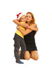 Embracing mother with son. With Santa hat isolated on white background stock photography