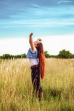 Embracing Nature. Attractive Young Lady Celebrating in a Field of Native Grass. Embracing Nature Stock Photo