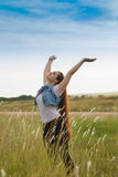 Embracing Nature. Attractive Young Lady Celebrating in a Field of Native Grass Stock Images