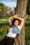 Embracing Nature. Attractive Young Lady posed against Tree Stock Photography