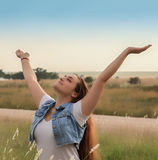 Embracing Nature. Attractive young lady striking a Pose in Nature Stock Images