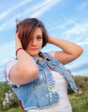 Embracing Nature. Attractive young lady striking a Pose in Nature Royalty Free Stock Photos