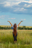Embracing Nature. Long Haired Young Lady Embracing The Moment and Nature Stock Photo