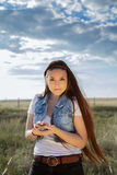 Embracing Nature. Lovely Young Lady embracing Nature in a Country Setting Royalty Free Stock Photography