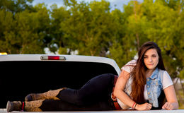 Embracing Nature. Portrait of Attractive Young Lady on back of pick up truck Royalty Free Stock Image