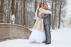 Embracing newly wedding couple in winter season Royalty Free Stock Image