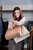 Embracing paper bags Royalty Free Stock Image