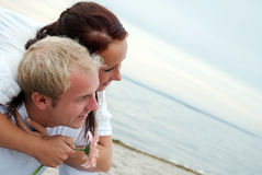 Embracing partners on beach Stock Photos