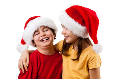 Embracing Santa Claus kids. Christmas time - kids wearing Santa Claus hat isolated on white Royalty Free Stock Image