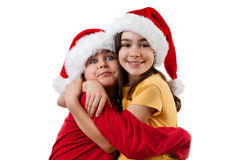 Embracing Santa Claus kids. Christmas time - kids wearing Santa Claus hat isolated on white Royalty Free Stock Photography