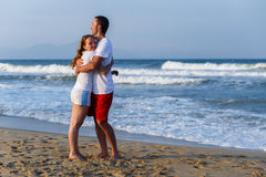 Embracing by the sea Stock Photos