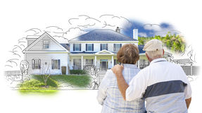 Embracing Senior Couple Over House Drawing and Photo on White Stock Images