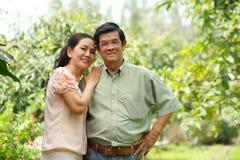 Embracing senior couple Stock Photo