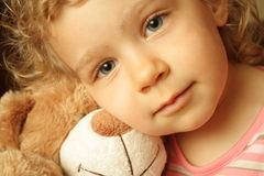 Embracing a teddy bear. Portrait of the child with the teddy bear stock image