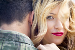 Embracing young couple. Young Couple Embracing close up Royalty Free Stock Photography